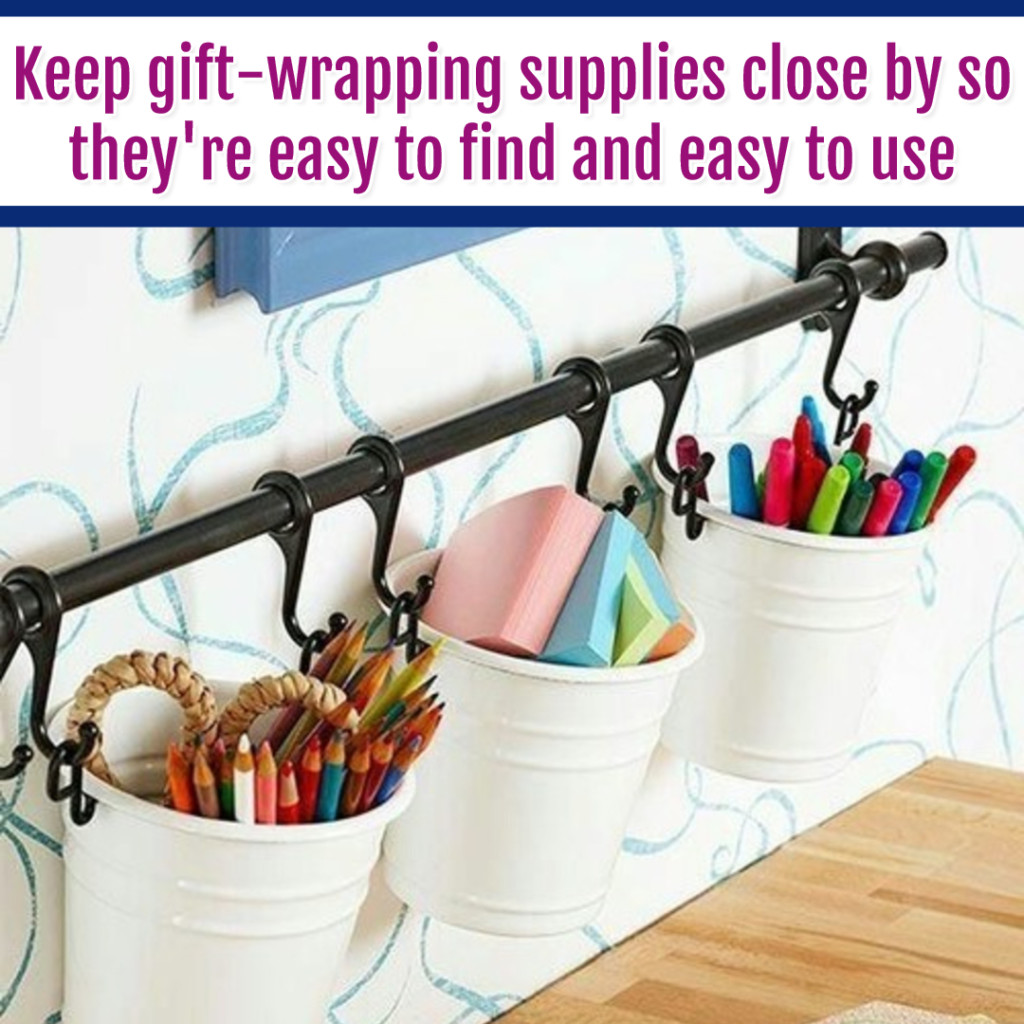 Organize Wrapping Supplies and Wrapping Paper - Organization Ideas: hang gift wrapping supplies on the wall with cheap dollar store buckets