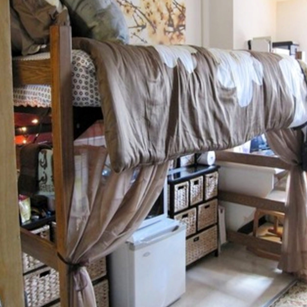 Under dorm room bed organization and set up ideas to create more closet space in small dorm rooms